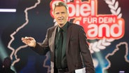 """Moderator Jörg Pilawa in der Quizshow """"Spiel für dein Land"""". © ARD Fotograf: Max Kohr"""